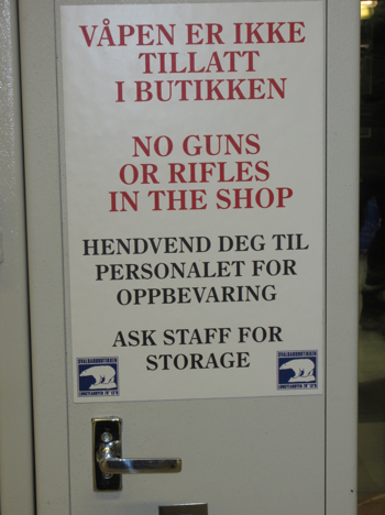 Figure 4. Gun storage locker and warning at the entrance of the supermarket in Longyearbyen. Photo by the author.