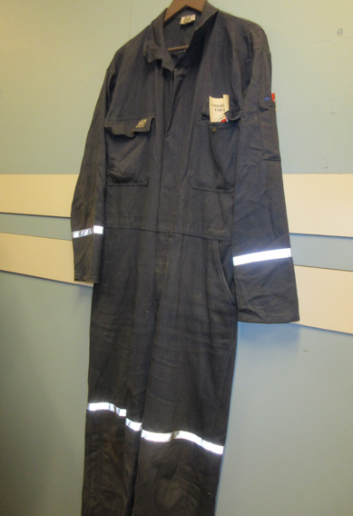 Figure 5. A miner's work suit (lompen) hanging near the entrance to mine 3. Note the reflective bars on the suit to facilitate seeing fellow miners in the depths (and darkness) of the mine. Photo by the author.