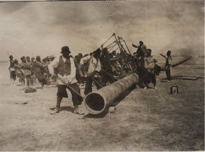 Figure 3. Iranian workers building a pipeline leading to the Abadan refinery, 1908. Retrieved from 'http://www.iichs.org/srcfiles/printmag.asp?id=180'. Free of copyright restrictions (in the public domain).