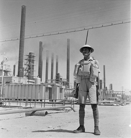 Indian soldier guarding an AIOC refinery, 1941. Retrieved from 'http://media.iwm.org.uk/ciim5/293/637/large_000000.jpg'. Free of copyright restrictions (in the public domain).